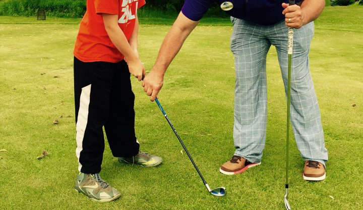 Children taking golf lessons