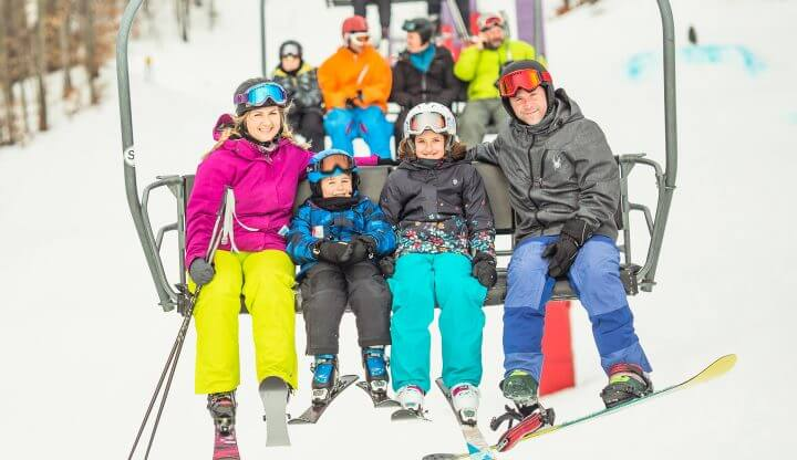skiing family on chairlift