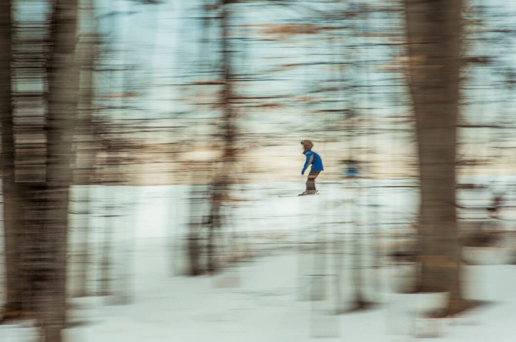 skier viewed through the trees