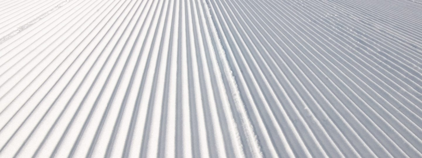 corduroy groomed ski slopes