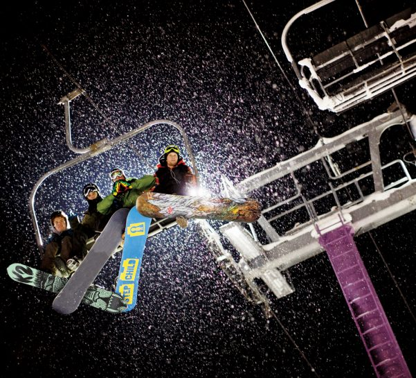 purple chairlift at night