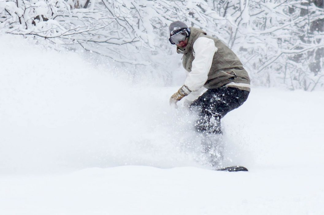 snowboarder in heavy powder snow