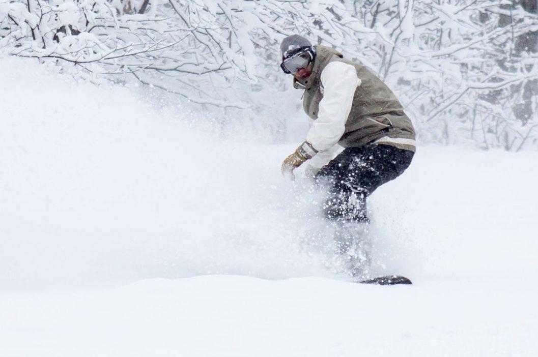 snowboarder in heavy powder snow