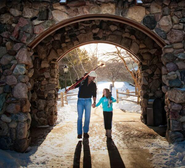 father-daughter walking through the arch
