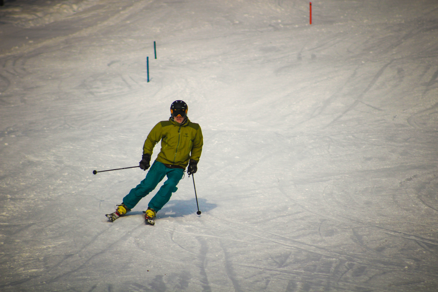 skier in green outfit