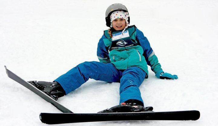 child taking ski lessons