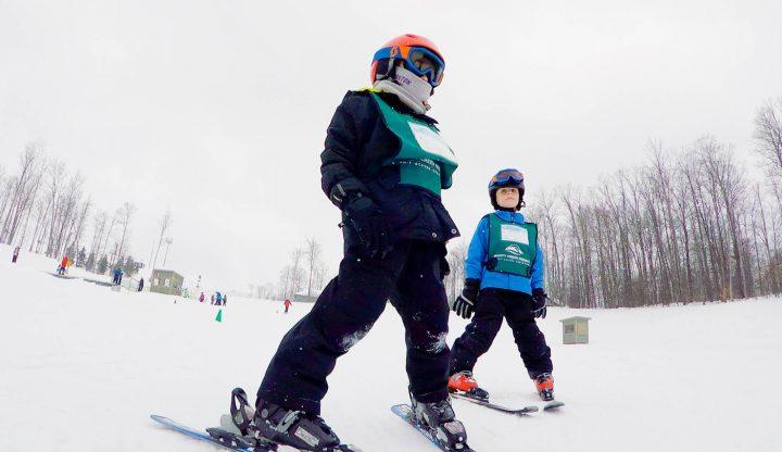 children taking ski lessons