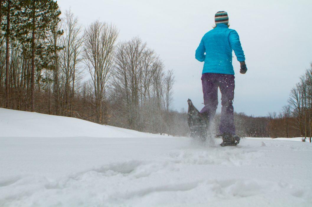 snowshoer running