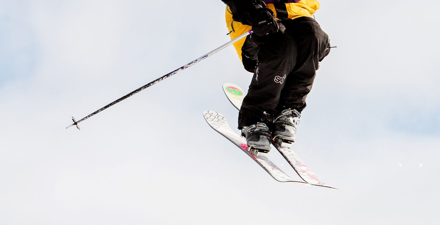 Skier in Purple Daze Terrain Park Midair