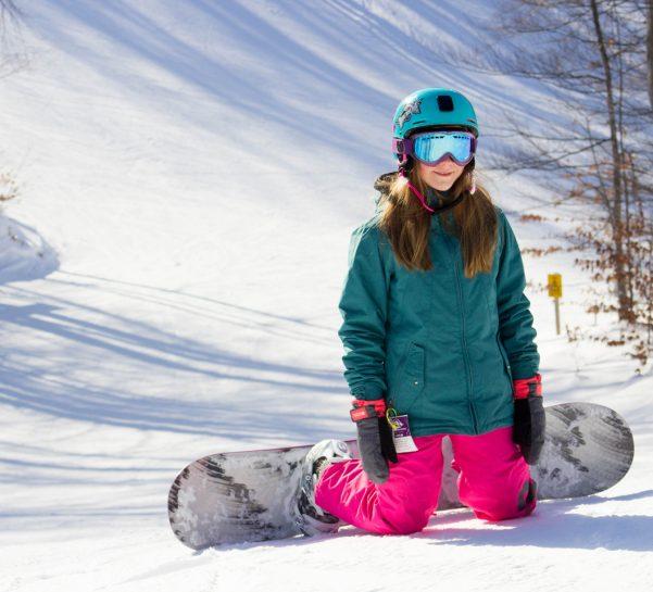 Girl Snowboarder Sitting