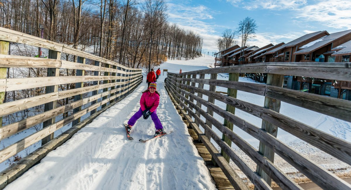 Child on Over ski run