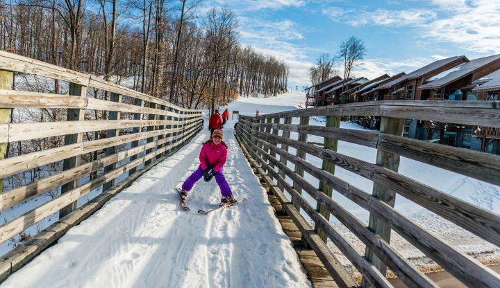 Child on Over ski run