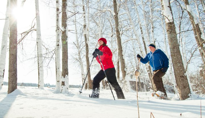 Couple snowshoeing together