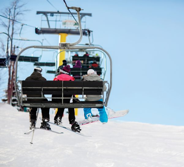 group of 3 on yellow chairlift