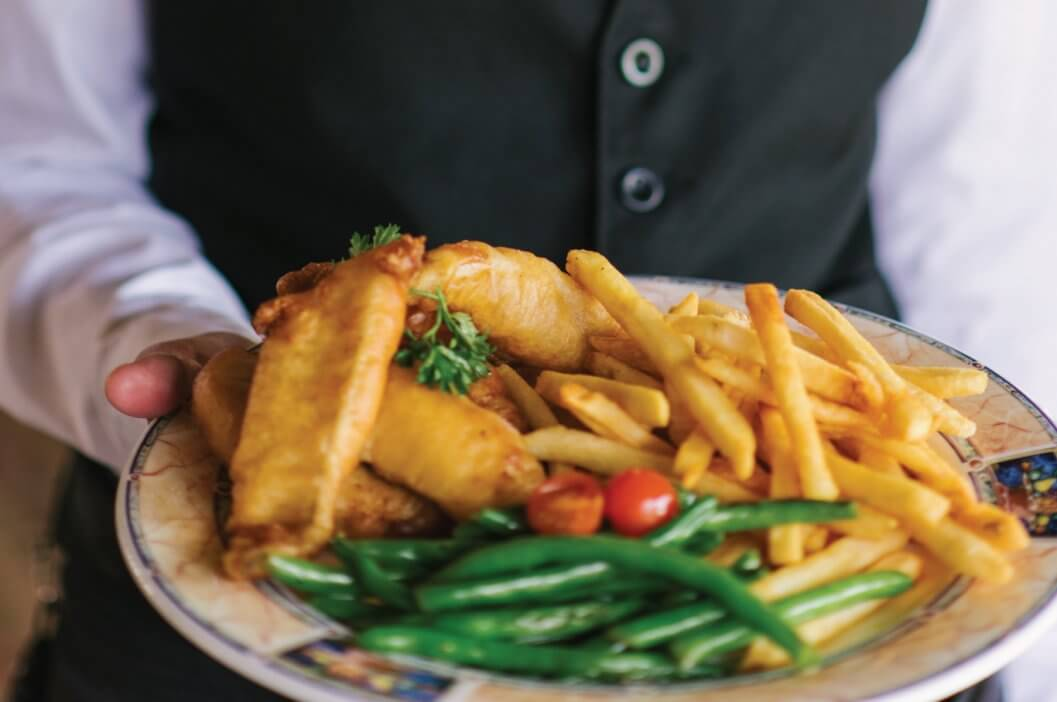 Fish and chips being served