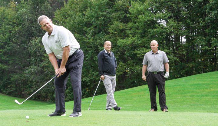 Golf pros at teebox