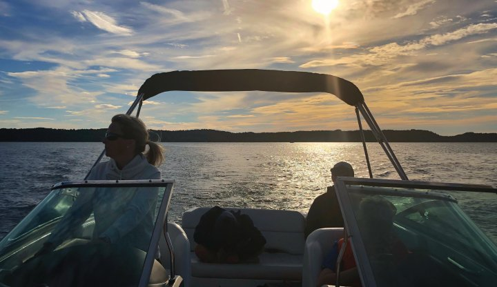 Boating on Torch Lake as the sun sets to the west
