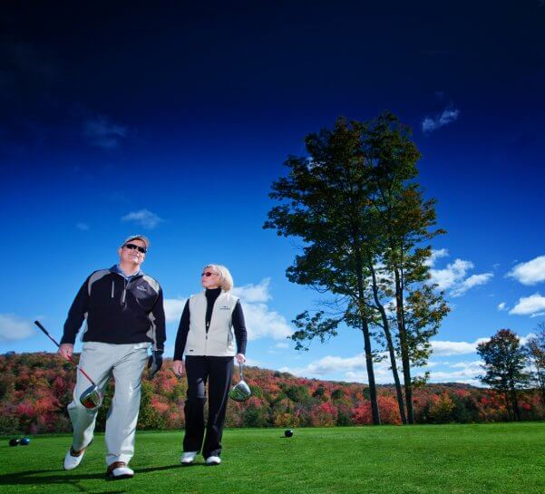 Couple Golfing in the Fall Colors at Cedar River GC