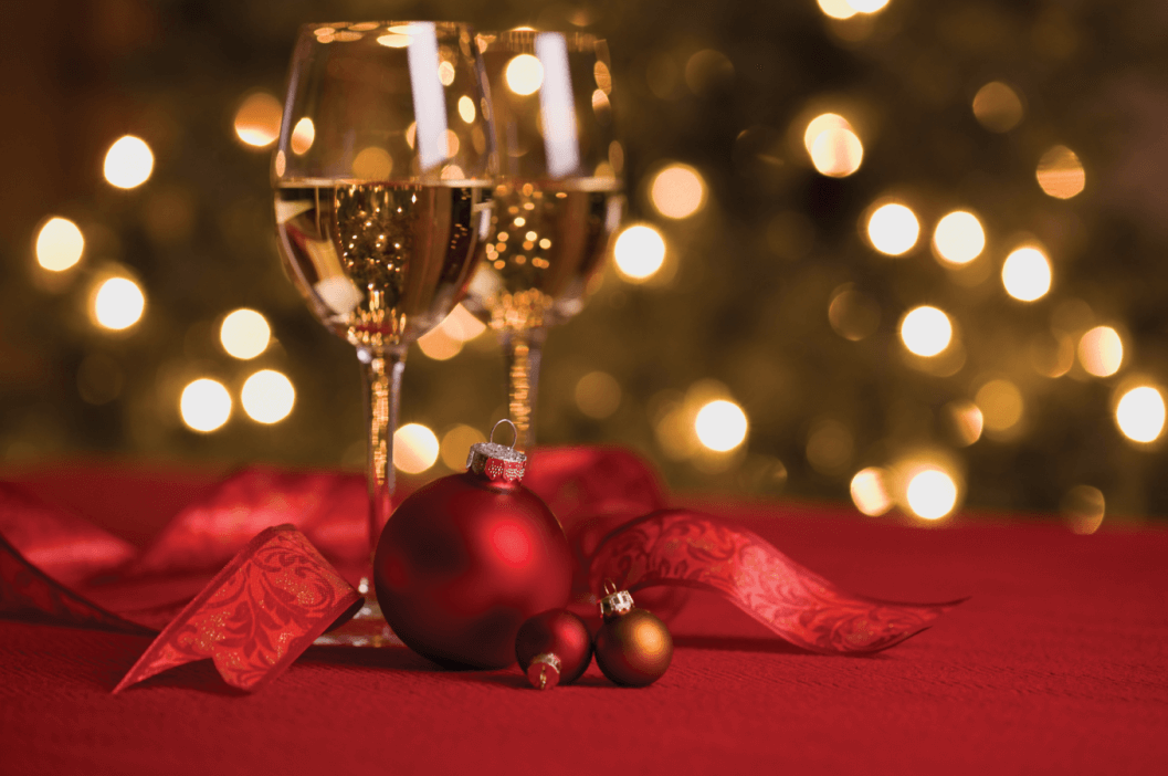 Wine and Ornaments in a Holiday Setting