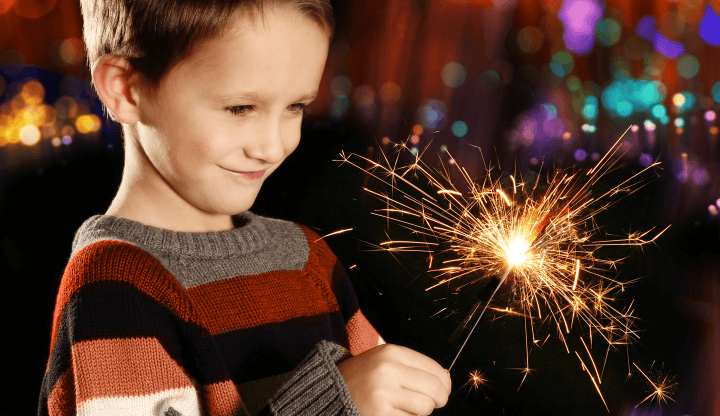 Boy celebrating New Year's Eve with a Sparkler