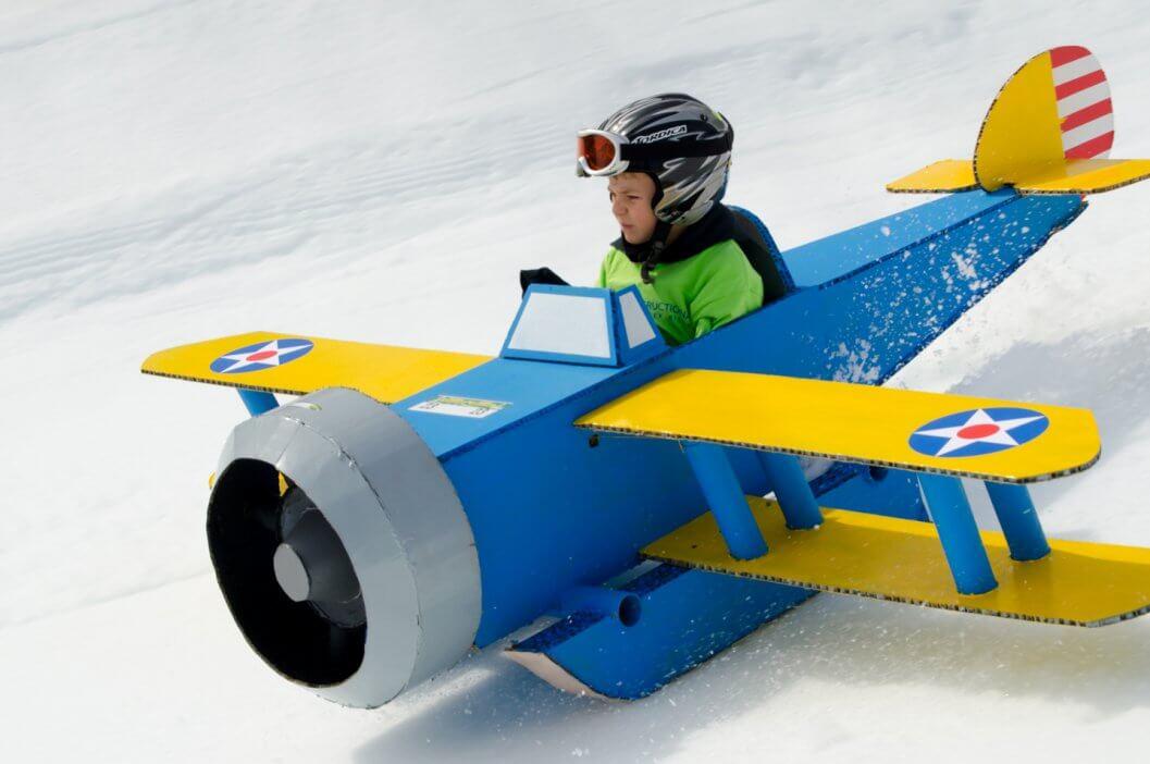 Cardboard Classic racer on cardboard airplane sled