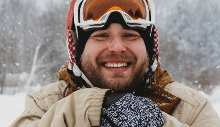 Man posing with Snowboard