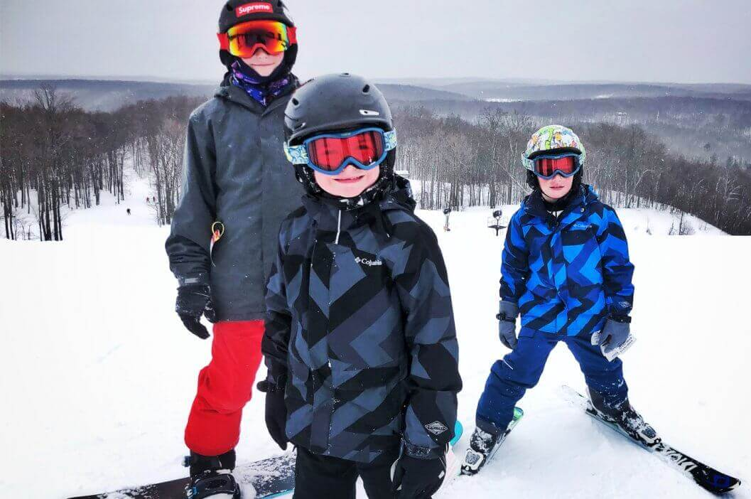 Skiing & Snowboarding Children Posing at the Top of Schuss Mountain