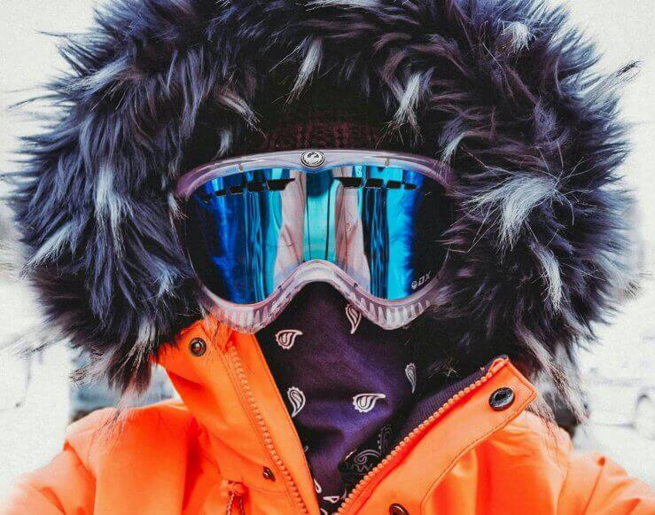 Close up of woman skier's goggled face.