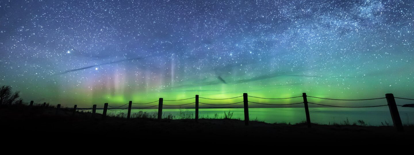 Northern Lights above in Bellaire Michigan. Photo by Heather Higham, SnapHappyGal.