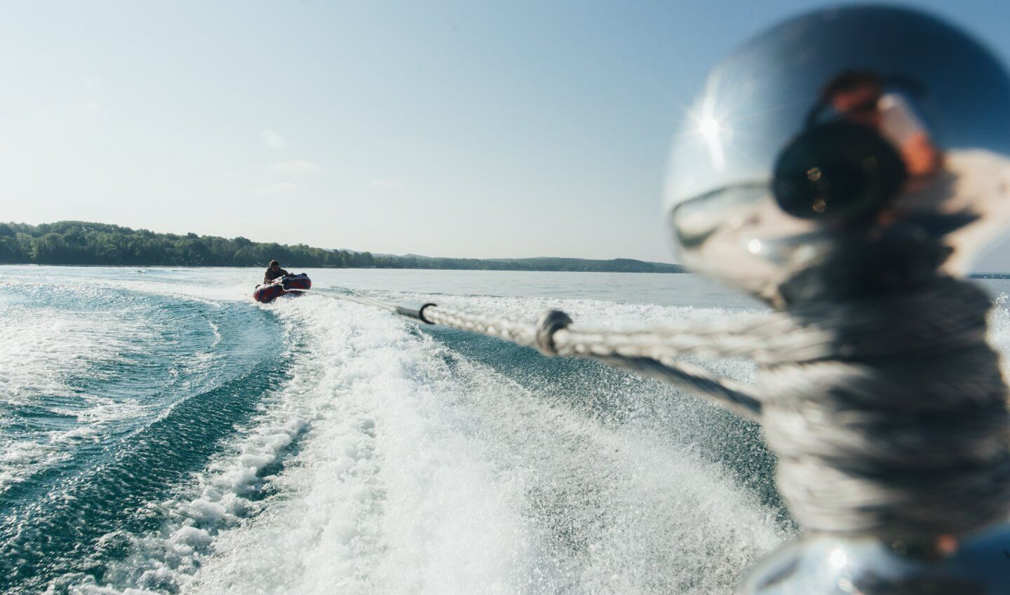 Riding a tube on Torch Lake