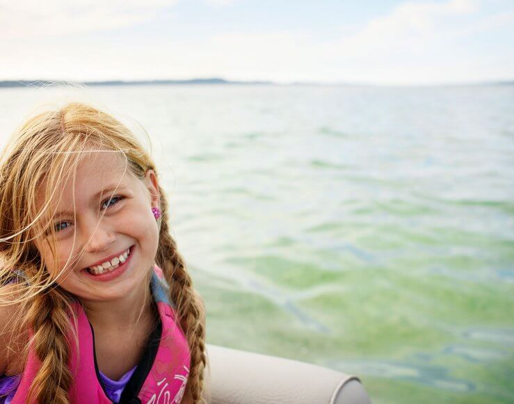 Girl on Boat on Torch Lake