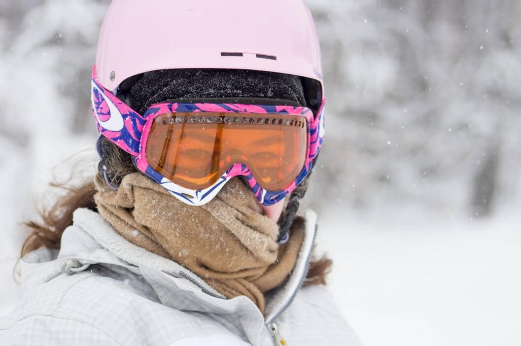Portrait of female skier with mask