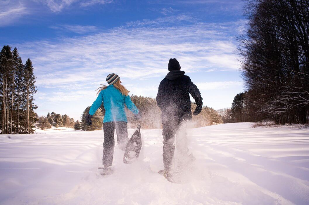 A couple snowshoeing