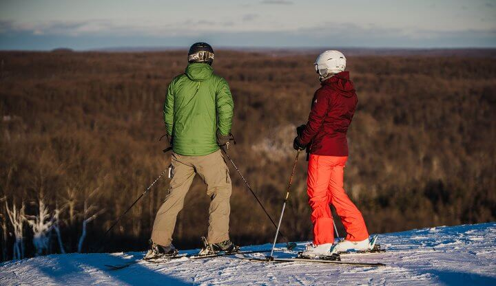 Skiers on top of Schuss Mountain